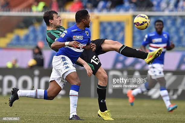 Samuel Eto o of UC Sampdoria is challenged by Francesco Acerbi of US Sassuolo Calcio during the Serie A match between UC Sampdoria and US Sassuolo...