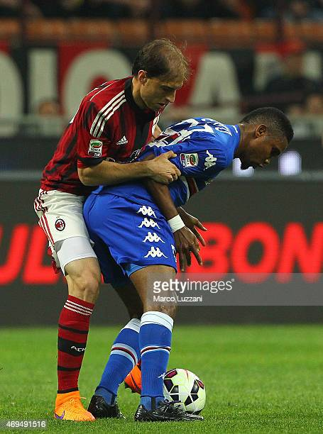 Samuel Eto o of UC Sampdoria is challenged by Gabriel Paletta of AC Milan during the Serie A match between AC Milan and UC Sampdoria at Stadio...
