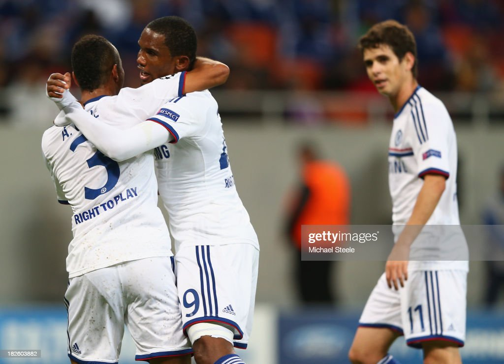 Samuel Eto (C) of Chelsea celebrates with Ashley Cole after his shot lead to his sides second goal during the UEFA Champions League Group E Match between FC Steaua Bucuresti and Chelsea at the National Arena Stadium on October 1, 2013 in Bucharest, Romania.