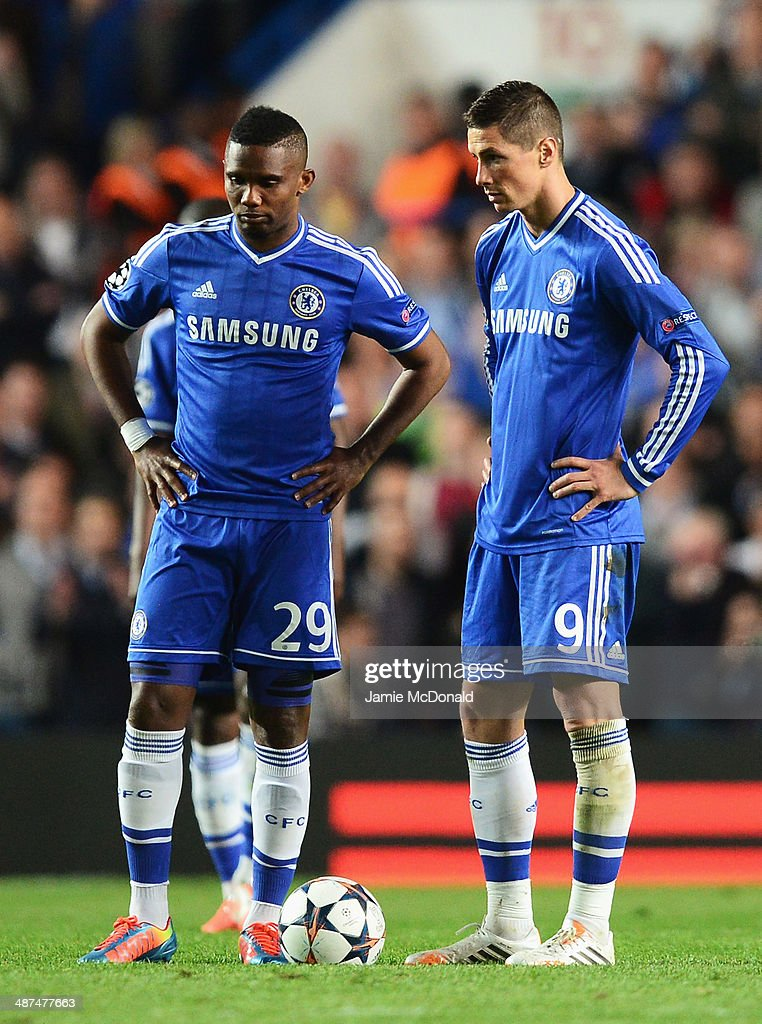 Samuel Eto'o and Fernando Torres of Chelsea look dejected after the goal by Diego Costa of Club Atletico de Madrid during the UEFA Champions League semi-final second leg match between Chelsea and Club Atletico de Madrid at Stamford Bridge on April 30, 2014 in London, England.