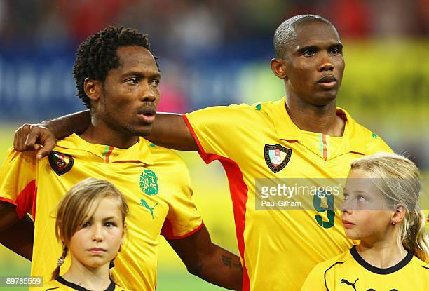Samuel Eto'o and LL Jean Makoun of Cameroon look on during the Cameroon national anthem prior to the International Friendly match between Austria and...
