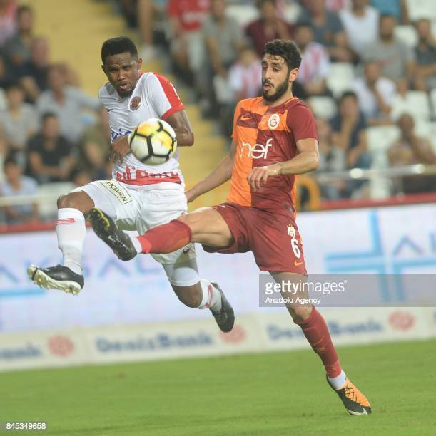 Samuel Eto'o of Antalyaspor in action against Tolga Cigerci of Galatasaray during the 4th week of the Turkish Super Lig match between Antalyaspor and...