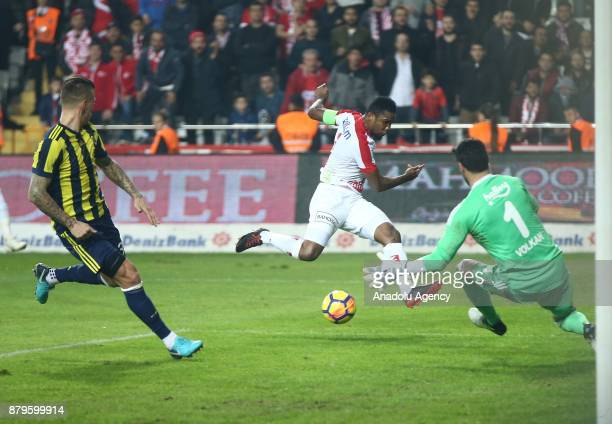 Samuel Eto'o of Antalyaspor in action against Volkan Demirel of Fenerbahce during the Turkish Super Lig match between Antalyaspor and Fenerbahce at...