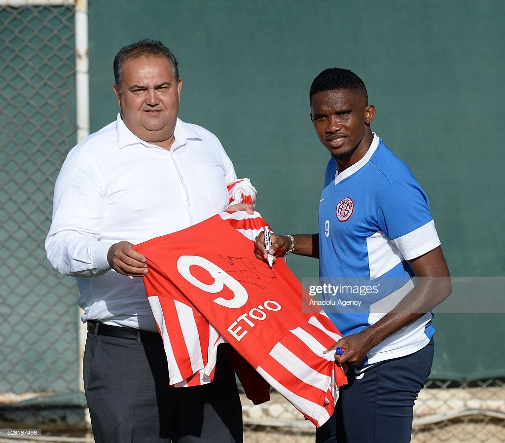Samuel Eto'o of Antalyaspor signs a jersey for his fan during a training session ahead of the Spor Toto Super Lig match between Antalyaspor and Mersin Idman Yurdu in Antalya, Turkey on May 4, 2016.