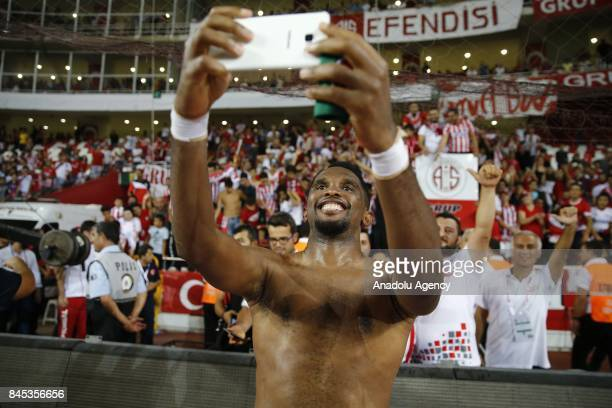 Samuel Etoo of Antalyaspor takes a selfie with fans at the end of the 4th week of the Turkish Super Lig match between Antalyaspor and Galatasaray at...