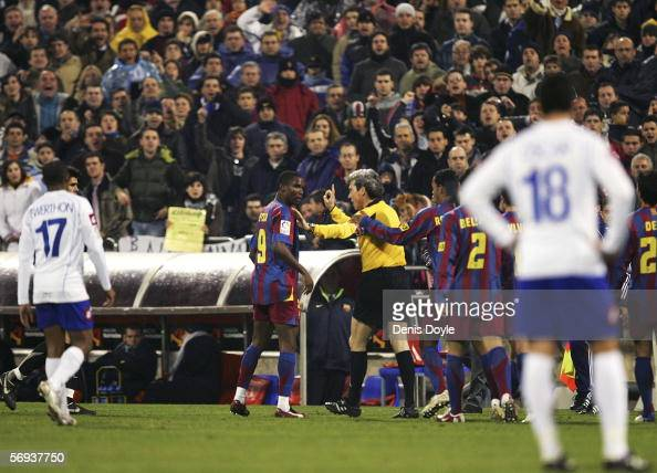 Samuel Eto'o of Barcelona is persuaded by referee Esquinas Torres from abandoning the Primera Liga match against Real Zaragoza after some Zaragoza...