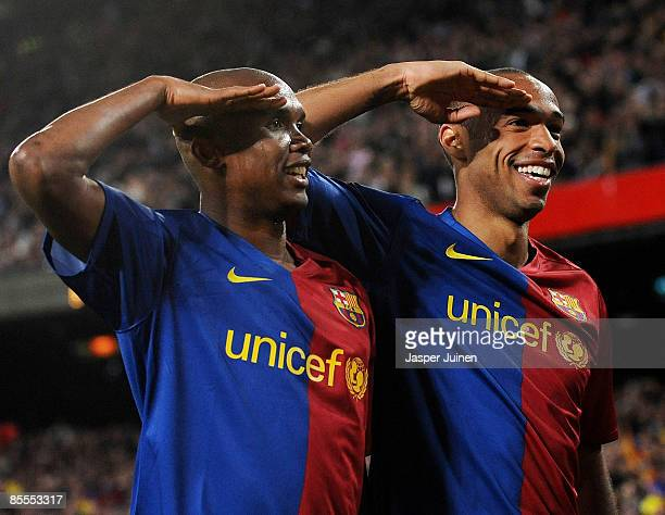 Samuel Eto'o of Barcelona salutes the crowd with his team mate Thierry Henry as he celebrates scoring his side's sixth goal during the La Liga match...