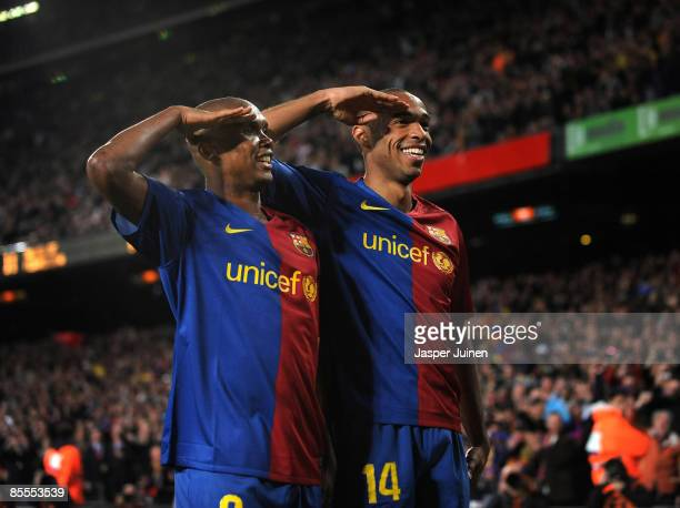 Samuel Eto'o of Barcelona salutes the crowd with his teammate Thierry Henry celebrating scoring his sides sixth goal during the La Liga match between...