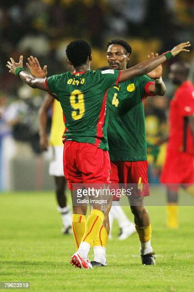 Samuel Eto'o of Cameroon and Rigobert Song of Cameroon celebrate during of the AFCON semifinal match between Ghana and Cameroon held at the Ohene...