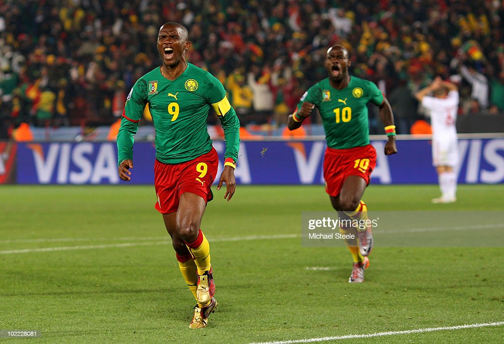 <a gi-track='captionPersonalityLinkClicked' href=/galleries/search?phrase=Samuel+Eto%27o&family=editorial&specificpeople=210530 ng-click='$event.stopPropagation()'>Samuel Eto'o</a> (L) of Cameroon celebrates scoring the first goal with team mate <a gi-track='captionPersonalityLinkClicked' href=/galleries/search?phrase=Achille+Emana&family=editorial&specificpeople=801756 ng-click='$event.stopPropagation()'>Achille Emana</a> during the 2010 FIFA World Cup South Africa Group E match between Cameroon and Denmark at Loftus Versfeld Stadium on June 19, 2010 in Tshwane/Pretoria, South Africa.