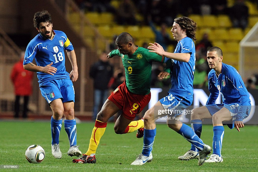 <a gi-track='captionPersonalityLinkClicked' href=/galleries/search?phrase=Samuel+Eto%27o&family=editorial&specificpeople=210530 ng-click='$event.stopPropagation()'>Samuel Eto'o</a> of Cameroon (2ndL) is Challenged by <a gi-track='captionPersonalityLinkClicked' href=/galleries/search?phrase=Riccardo+Montolivo&family=editorial&specificpeople=605846 ng-click='$event.stopPropagation()'>Riccardo Montolivo</a> (2ndR) of Italy as <a gi-track='captionPersonalityLinkClicked' href=/galleries/search?phrase=Gennaro+Gattuso&family=editorial&specificpeople=210827 ng-click='$event.stopPropagation()'>Gennaro Gattuso</a> (L) and Leonardo Bonucci look on during the International Friendly match between Italy and Cameroon at Louis II Stadium on March 3, 2010 in Monaco, Monaco.