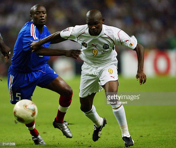 Samuel Eto'o of Cameroon takes the ball past William Gallas of France during the FIFA Confederations Cup Final between France and Cameroon held on...