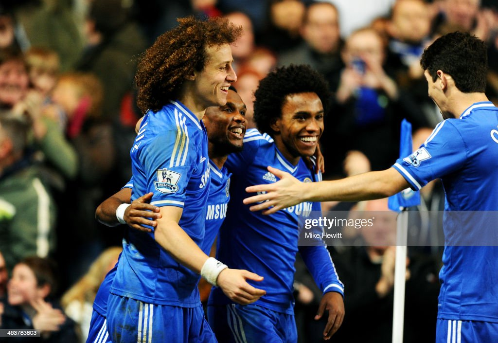 <a gi-track='captionPersonalityLinkClicked' href=/galleries/search?phrase=Samuel+Eto%27o&family=editorial&specificpeople=210530 ng-click='$event.stopPropagation()'>Samuel Eto'o</a> (2nd L) of Chelsea celebrates with teammates <a gi-track='captionPersonalityLinkClicked' href=/galleries/search?phrase=David+Luiz&family=editorial&specificpeople=4133397 ng-click='$event.stopPropagation()'>David Luiz</a> (L), <a gi-track='captionPersonalityLinkClicked' href=/galleries/search?phrase=Willian+-+Soccer+Player+for+Chelsea+and+Brazil&family=editorial&specificpeople=9886576 ng-click='$event.stopPropagation()'>Willian</a> (2nd R) and Oscar (R) after scoring his team's third goal and completing his hat trick during the Barclays Premier League match between Chelsea and Manchester United at Stamford Bridge on January 19, 2014 in London, England.