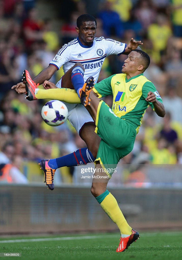 Samuel Eto'o of Chelsea clashes with Martin Olsson of Norwich City during the Barclays Premier League match between Norwich City and Chelsea at Carrow Road on October 6, 2013 in Norwich, England.