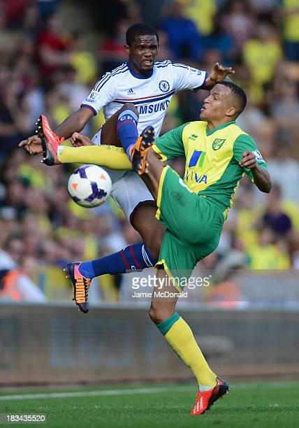 Samuel Eto'o of Chelsea clashes with Martin Olsson of Norwich City during the Barclays Premier League match between Norwich City and Chelsea at...