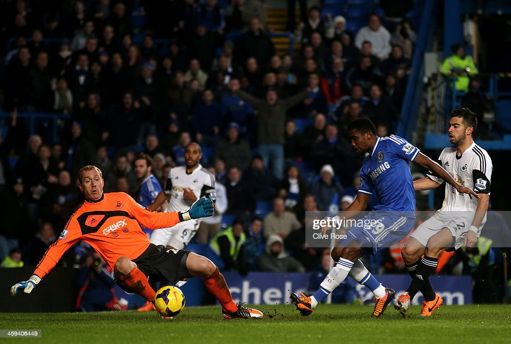 <a gi-track='captionPersonalityLinkClicked' href=/galleries/search?phrase=Samuel+Eto%27o&family=editorial&specificpeople=210530 ng-click='$event.stopPropagation()'>Samuel Eto'o</a> of Chelsea has a shot saved by <a gi-track='captionPersonalityLinkClicked' href=/galleries/search?phrase=Gerhard+Tremmel&family=editorial&specificpeople=751125 ng-click='$event.stopPropagation()'>Gerhard Tremmel</a> of Swansea City during the Barclays Premier League match between Chelsea and Swansea City at Stamford Bridge on December 26, 2013 in London, England.