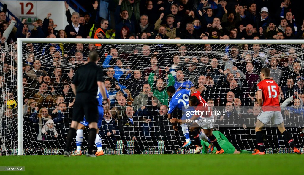 <a gi-track='captionPersonalityLinkClicked' href=/galleries/search?phrase=Samuel+Eto%27o&family=editorial&specificpeople=210530 ng-click='$event.stopPropagation()'>Samuel Eto'o</a> of Chelsea scores his team's third goal and comples his hat trick despite the challenge from <a gi-track='captionPersonalityLinkClicked' href=/galleries/search?phrase=Antonio+Valencia&family=editorial&specificpeople=543830 ng-click='$event.stopPropagation()'>Antonio Valencia</a> of Manchester United during the Barclays Premier League match between Chelsea and Manchester United at Stamford Bridge on January 19, 2014 in London, England.
