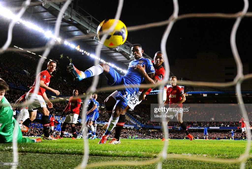 <a gi-track='captionPersonalityLinkClicked' href=/galleries/search?phrase=Samuel+Eto%27o&family=editorial&specificpeople=210530 ng-click='$event.stopPropagation()'>Samuel Eto'o</a> of Chelsea scores his team's third goal and completes his hat trick despite the challenge from <a gi-track='captionPersonalityLinkClicked' href=/galleries/search?phrase=Antonio+Valencia&family=editorial&specificpeople=543830 ng-click='$event.stopPropagation()'>Antonio Valencia</a> of Manchester United during the Barclays Premier League match between Chelsea and Manchester United at Stamford Bridge on January 19, 2014 in London, England.