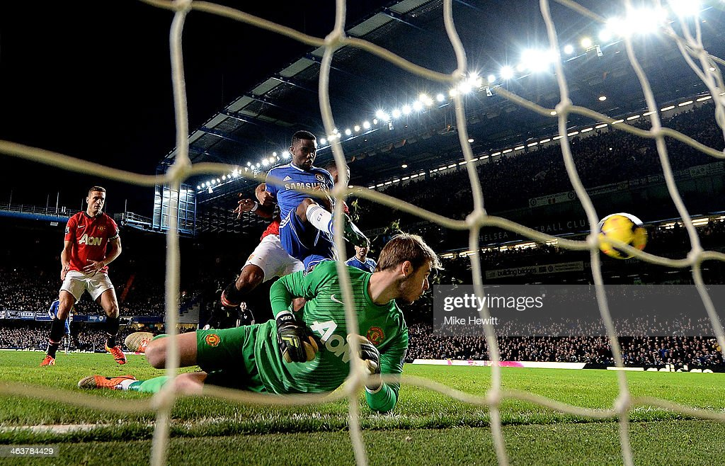 <a gi-track='captionPersonalityLinkClicked' href=/galleries/search?phrase=Samuel+Eto%27o&family=editorial&specificpeople=210530 ng-click='$event.stopPropagation()'>Samuel Eto'o</a> of Chelsea scores his team's third goal past goalkeeper David De Gea of Manchester United and completes his hat trick during the Barclays Premier League match between Chelsea and Manchester United at Stamford Bridge on January 19, 2014 in London, England.