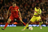 Samuel Eto'o of Fc Anji Makhachkala competes with Steven Gerrard of Liverpool during the UEFA Europa League Group A match between Liverpool FC and FC...