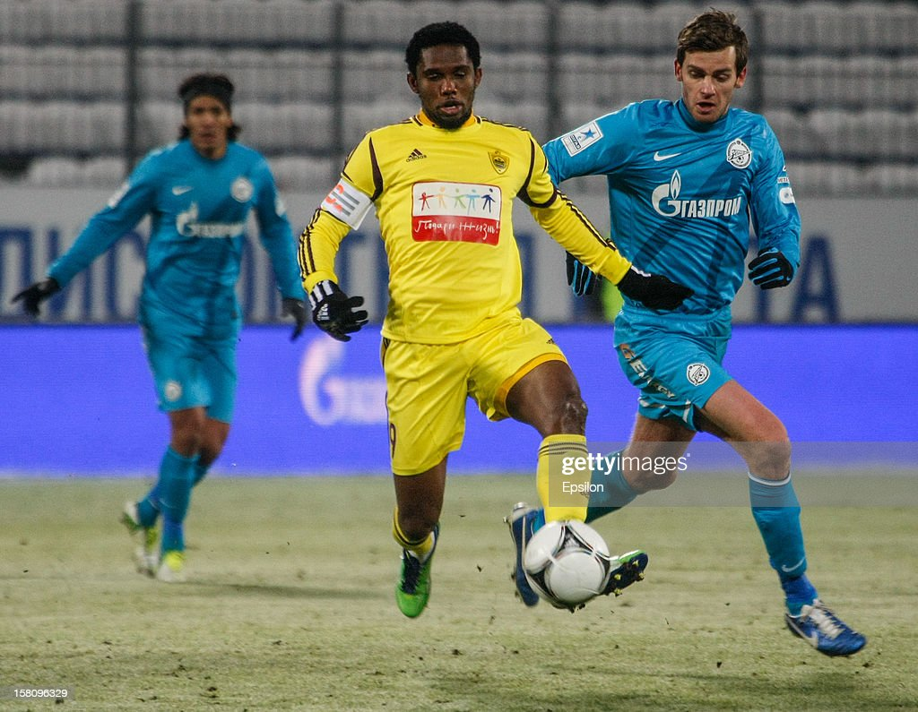 Samuel Eto'o of FC Anzhi Makhachkala (C) in action against Nicolas Lombaerts of FC Zenit St. Petersburg during the Russian Premier League match between FC Zenit St. Petersburg and FC Anzhi Makhachkala at the Petrovsky Stadium on December 10, 2012 in St. Petersburg, Russia.