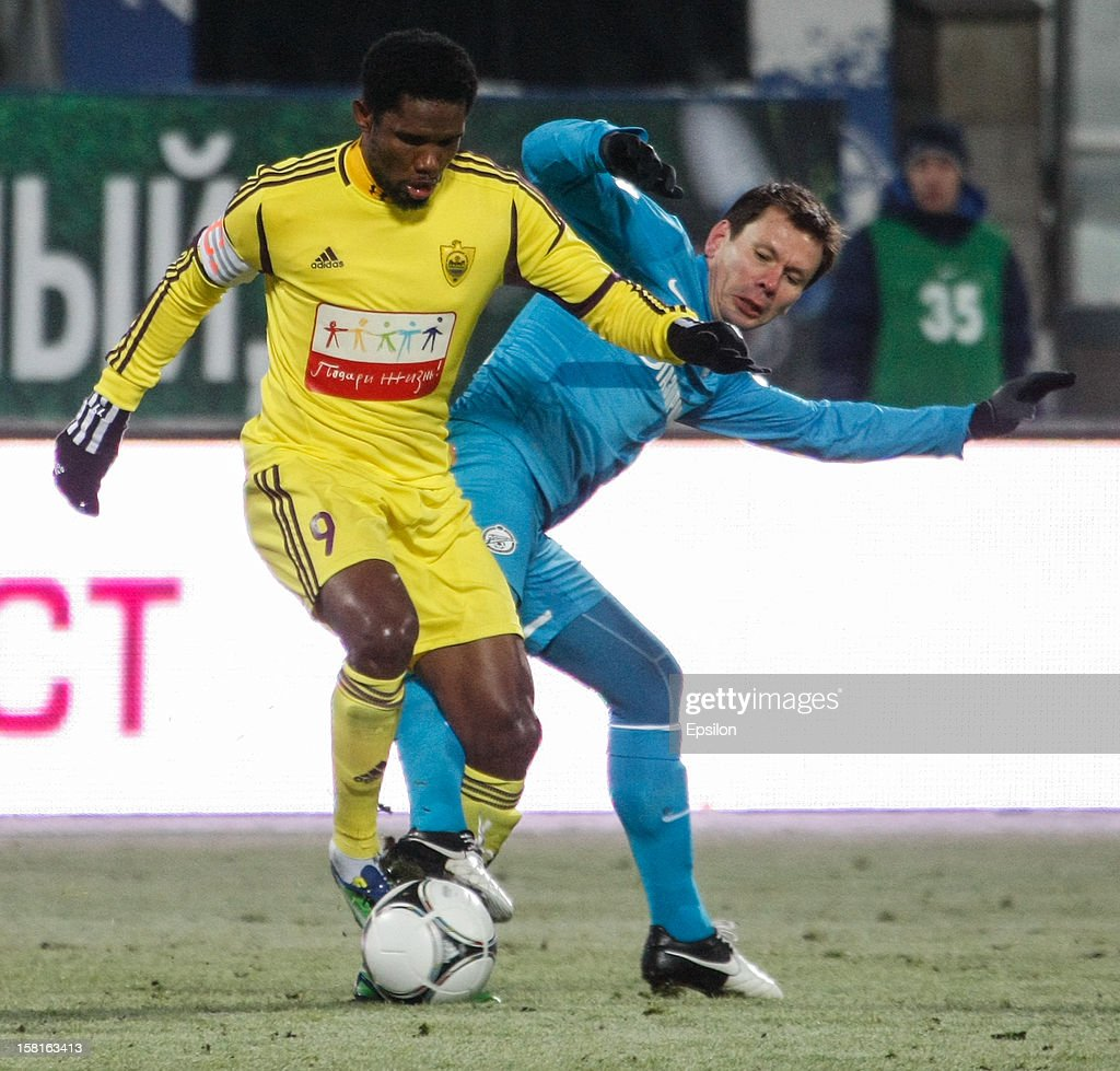 Samuel Eto'o of FC Anzhi Makhachkala (L) vies for the ball with Konstantin Zyryanov of FC Zenit St. Petersburg during the Russian Premier League match between FC Zenit St. Petersburg and FC Anzhi Makhachkala at the Petrovsky Stadium on December 10, 2012 in St. Petersburg, Russia.