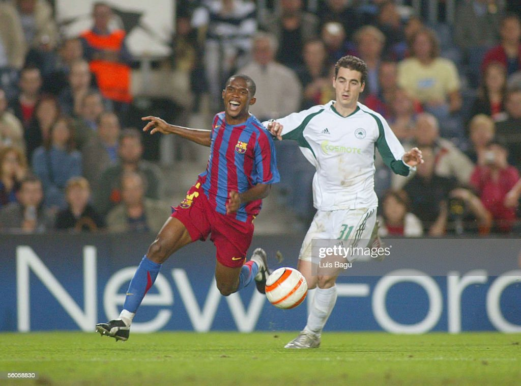 Samuel Eto'o (L) of FC Barcelona and Filippos Darlas of Panathinaikos in action during the UEFA Champions League group C match between FC Barcelona and Panathinaikos at the Camp Nou stadium on November 2, 2005 in in Barcelona, Spain.