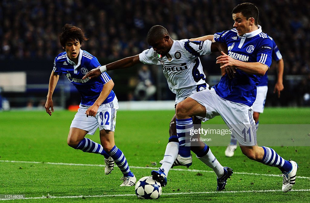 <a gi-track='captionPersonalityLinkClicked' href=/galleries/search?phrase=Samuel+Eto%27o&family=editorial&specificpeople=210530 ng-click='$event.stopPropagation()'>Samuel Eto'o</a> of Inter is challenged by <a gi-track='captionPersonalityLinkClicked' href=/galleries/search?phrase=Atsuto+Uchida&family=editorial&specificpeople=4318608 ng-click='$event.stopPropagation()'>Atsuto Uchida</a> and <a gi-track='captionPersonalityLinkClicked' href=/galleries/search?phrase=Alexander+Baumjohann&family=editorial&specificpeople=764148 ng-click='$event.stopPropagation()'>Alexander Baumjohann</a> of Schalke during the UEFA Champions League quarter final second leg match against Inter Milan at Veltins Arena on April 12, 2011 in Gelsenkirchen, Germany.