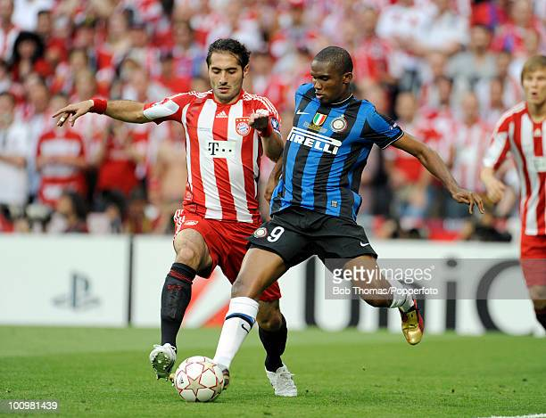 Samuel Eto'o of Inter Milan clashes with Hamit Altintop of Bayern Munich during the UEFA Champions League Final match between Bayern Munich and Inter...