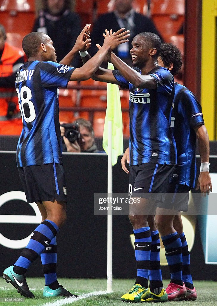 <a gi-track='captionPersonalityLinkClicked' href=/galleries/search?phrase=Samuel+Eto%27o&family=editorial&specificpeople=210530 ng-click='$event.stopPropagation()'>Samuel Eto'o</a> (R) of Milano celebrates with his team mate <a gi-track='captionPersonalityLinkClicked' href=/galleries/search?phrase=Jonathan+Biabiany&family=editorial&specificpeople=5973634 ng-click='$event.stopPropagation()'>Jonathan Biabiany</a> after scoring his team's fourth goal during the UEFA Champions League group A match between FC Internazionale Milano and SV Werder Bremen at Stadio Giuseppe Meazza on September 29, 2010 in Milan, Italy.