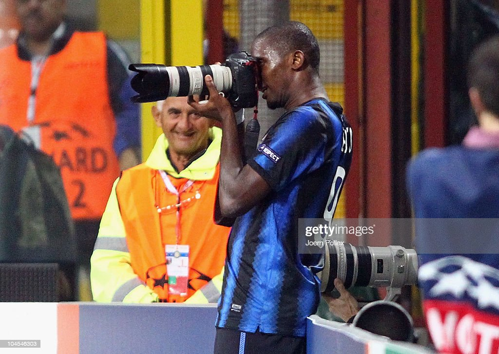 <a gi-track='captionPersonalityLinkClicked' href=/galleries/search?phrase=Samuel+Eto%27o&family=editorial&specificpeople=210530 ng-click='$event.stopPropagation()'>Samuel Eto'o</a> of Milano uses a journalists camera after scoring his team's fourth goal during the UEFA Champions League group A match between FC Internazionale Milano and SV Werder Bremen at Stadio Giuseppe Meazza on September 29, 2010 in Milan, Italy.