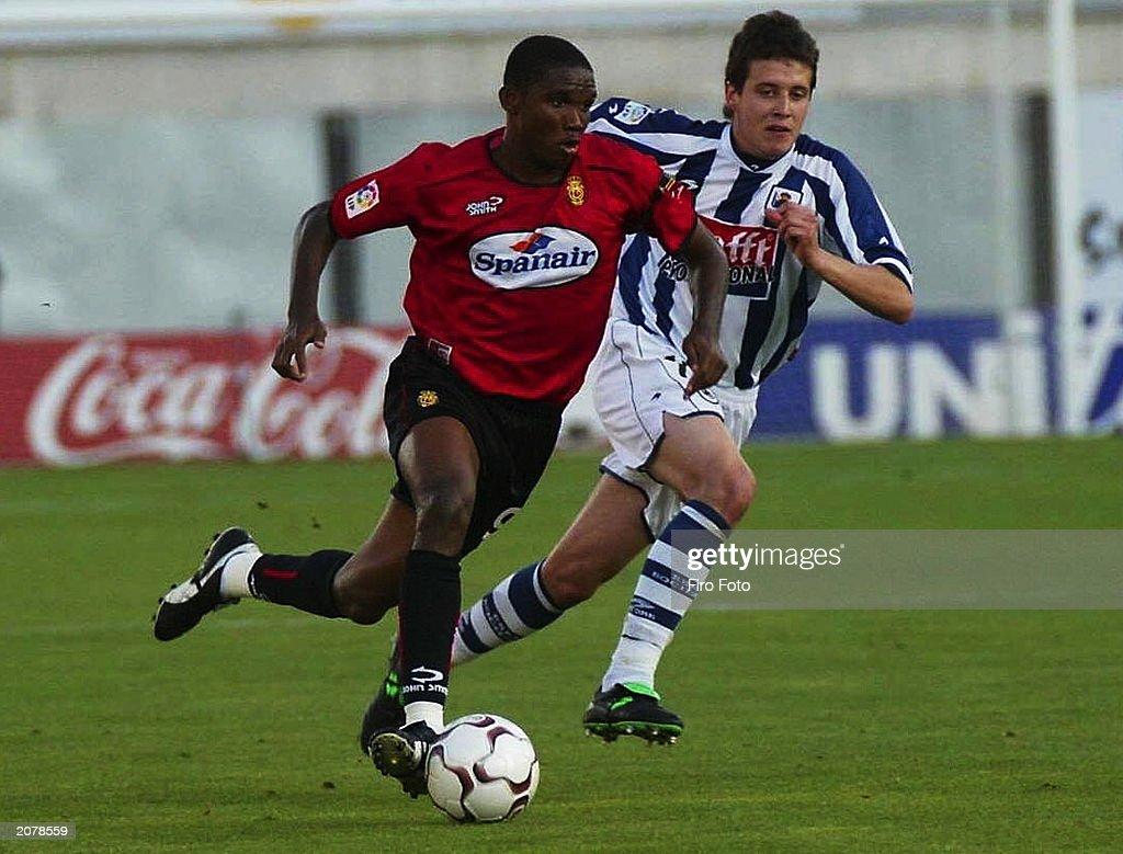 Samuel Eto o of Real Mallorca and Mikel Aranburu of Real Sociedad