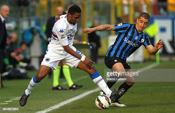 Samuel Eto'o of UC Sampdoria is challenged by Carlos Carmona of Atalanta BC during the Serie A match between Atalanta BC and UC Sampdoria at Stadio...