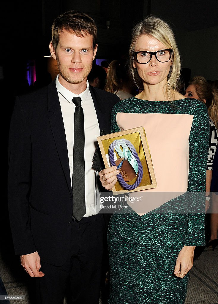 Samuel Fernstrom (L) and Anna Teurnell, winners of the Womenswear Design Team award for & other stories, pose backstage at The WGSN Global Fashion Awards at the Victoria & Albert Museum on October 30, 2013 in London, England.