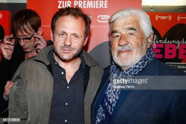 Samuel Finzi and Mario Adorf attend the 'Die Erfindung der Liebe' Cologne Premiere at Odeon Lichtspieltheater on April 29 2014 in Cologne Germany