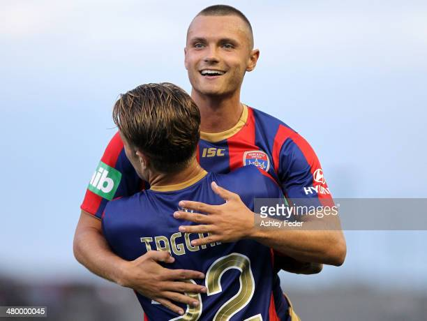 Samuel Gallaway and Adam Taggart of the Jets celebrate a goal during the round 24 ALeague match between the Newcastle Jets and Wellington Phoenix at...