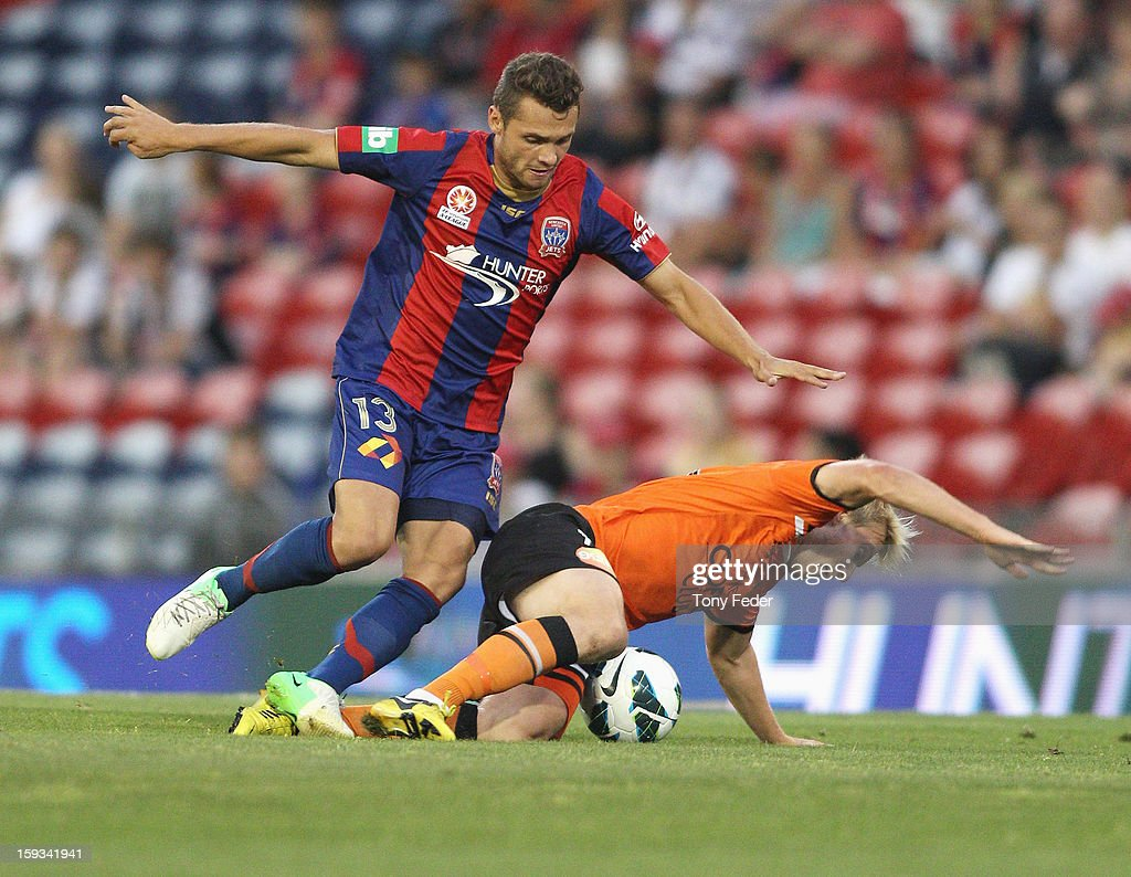 Samuel Galloway of the Jets and Ben Halloran of the Roar contest the ball during the round 16 A-League match between the Newcastle Jets and the Brisbane Roar at Hunter Stadium on January 12, 2013 in Newcastle, Australia.