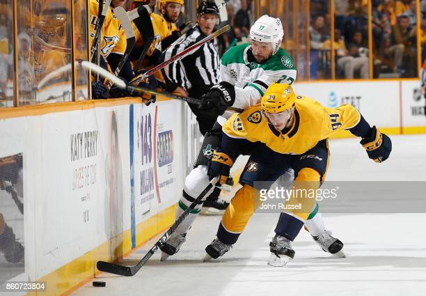 Samuel Girard of the Nashville Predators battles for the puck against Devin Shore of the Dallas Stars during an NHL game at Bridgestone Arena on...