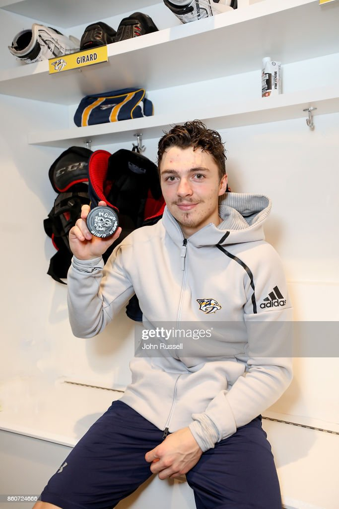 Samuel Girard #94 of the Nashville Predators holds the puck from his first career NHL goal scored during an NHL game against the Dallas Stars at Bridgestone Arena on October 12, 2017 in Nashville, Tennessee.