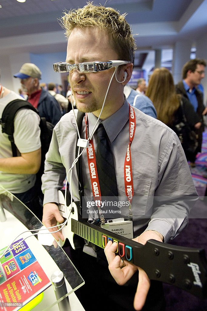 Samuel Goulet plays an XBOX Guitar as he tries on a pair of Myvu personal media viewer glasses at the 2008 International Consumer Electronics Show at the Las Vegas Convention Center January 9, 2008 in Las Vegas, Nevada. Myvu glasses allow you to to see your favorite music videos, movies, podcasts, or TV shows from your iPod, portable DVD player or MP4 player. CES, the world's largest annual consumer technology tradeshow, runs through tomorrow and features 2,700 exhibitors showing off their latest products and services to more than 140,000 attendees.