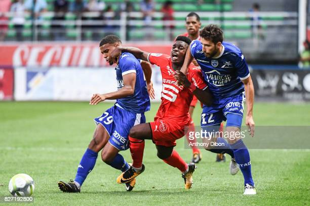 Samuel Grandsir of Troyes and Christ Maouassa of Rennes and MAthieu Deplagne of Troyes during the Ligue 1 match between Troyes AC and Stade Rennais...