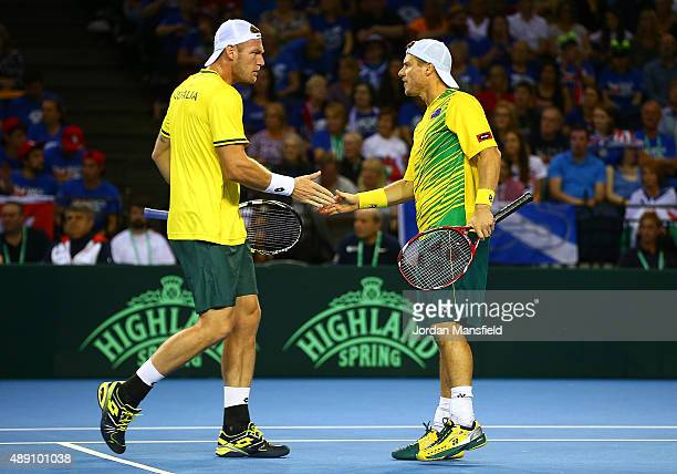 Samuel Groth of Australia celebrates a point with Lleyton Hewitt during Day Two of the Davis Cup Semi Final match between Great Britain and Australia...