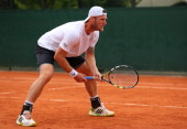 Samuel Groth of Australia in action next to his partner Andrey Golubev during his men's doubles match against Carlos Berlocq of Argentina and Daniele...