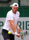 Samuel Groth of Australia returns a shot next to his partner Andrey Golubev during his men's doubles match against Carlos Berlocq of Argentina and...