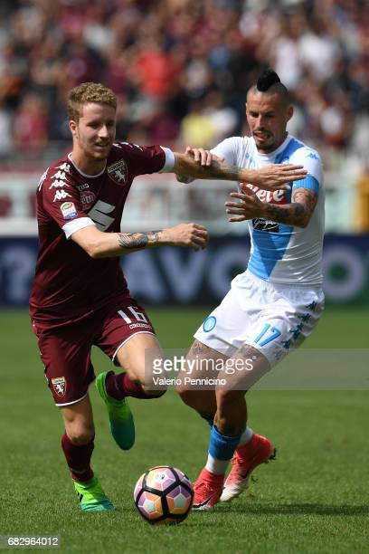 Samuel Gustafson of FC Torino competes with Marek Hamsik of SSC Napoli during the Serie A match between FC Torino and SSC Napoli at Stadio Olimpico...