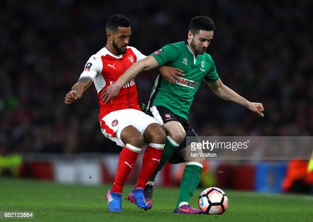 Samuel Habergham of Lincoln City battles with Theo Walcott of Arsenal during The Emirates FA Cup QuarterFinal match between Arsenal and Lincoln City...
