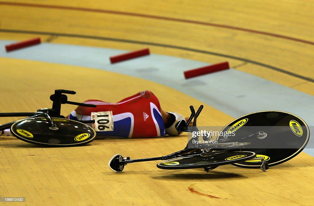 Samuel Harrison of Great Britain lies on the track after crashing during qualifying in the Men's Team Pursuit during day one of the UCI Track Cycling World Cup at the Sir Chris Hoy Velodrome on November 16, 2012 in Glasgow, Scotland.