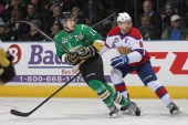 Samuel Henley of the Val'Dor Foreurs skates against Griffin Reinhart of the Edmonton Oil Kings in Game Five of the 2014 MasterCard Memorial Cup at...