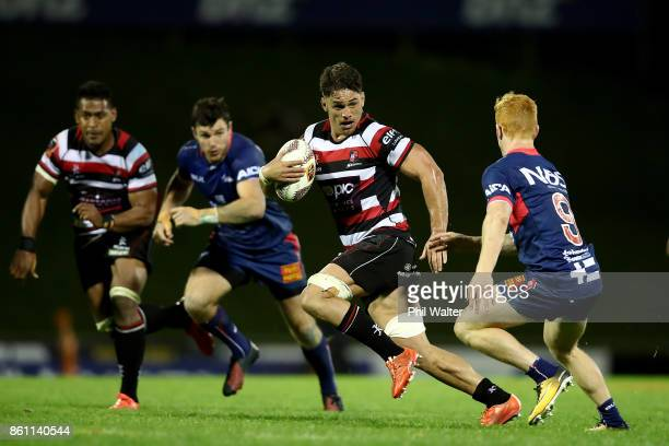 Samuel Henwood of Counties is tackled by Finlay Christie of Tasman during the round nine Mitre 10 Cup match between Counties Manukau and Tasman at...