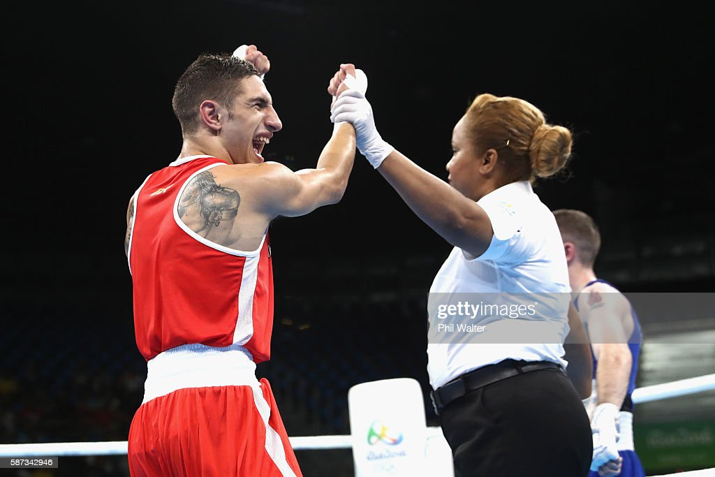Samuel Heredia Carmona of Spain celebrates victory against Patrick Barnes of Ireland in their Mens 4649 Light Fly Weight bout on Day 3 of the Rio...